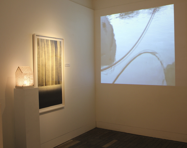 Projection of 'Recurring Dream' and wall piece and house for '....a little rain...'