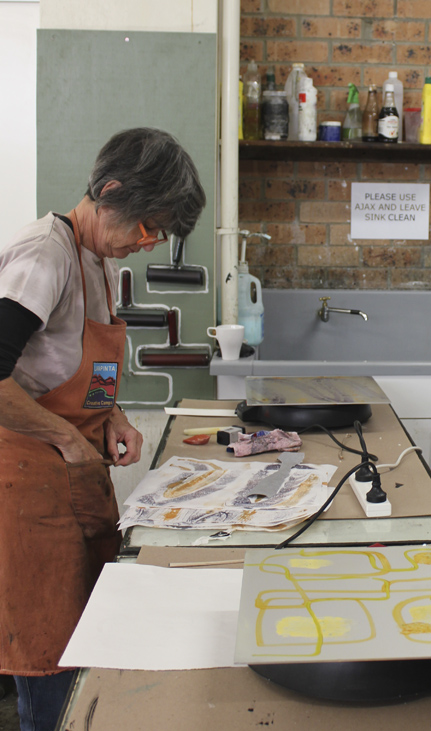 Chris Hutch exploring encaustic monotypes. Brenda's plate is in the foreground.